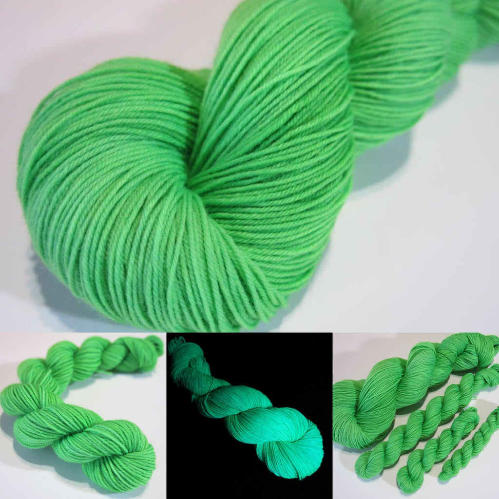 hand dyed kelly green yarn fluorescing under uv black light