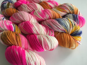 hand dyed uv reactive pink and orange DK yarn skein