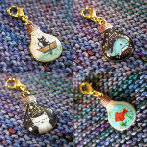 enamel cat and fish stitch markers and progress keepers for knitting