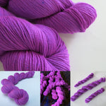 hand dyed neon purple fluorescent yarn by my mama knits