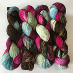 indie dyed sock yarn skeins in brown, pink, blue and green