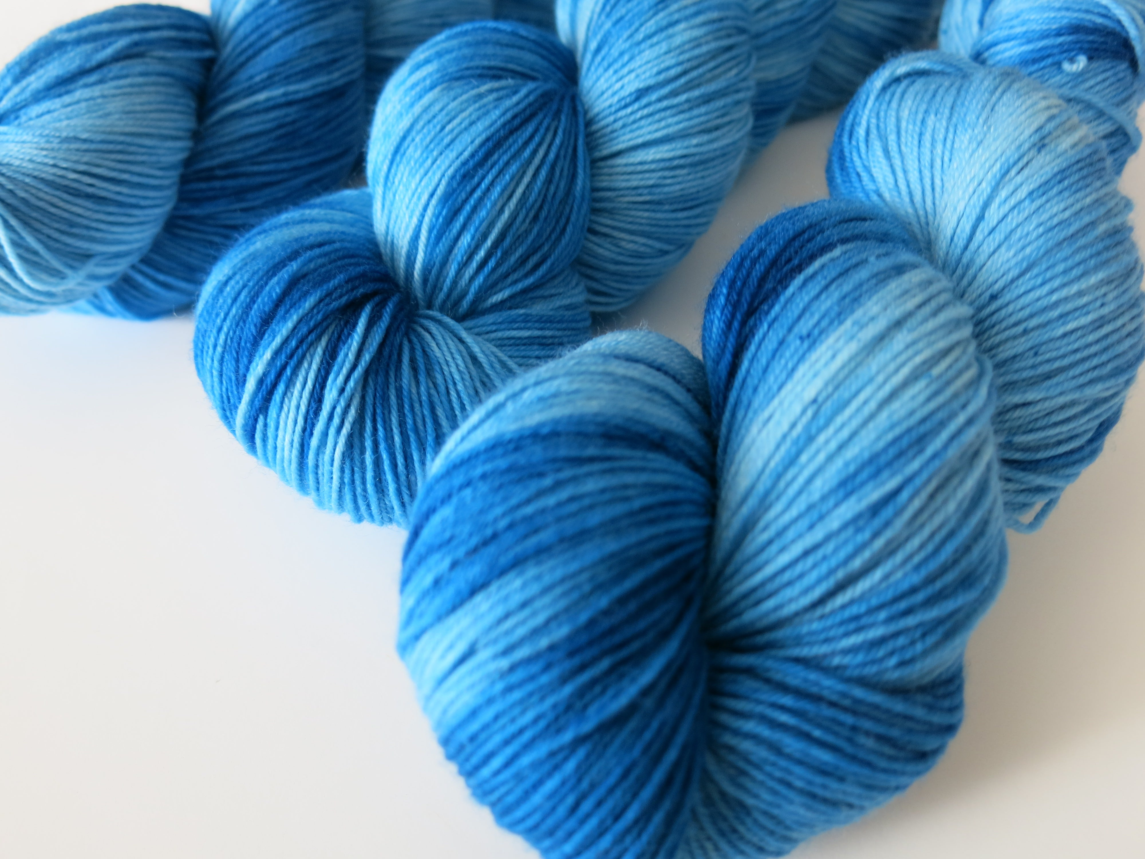 indie dyed bright blue merino yarn skeins for hand knits
