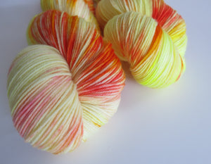 100g choufunga sock yarn skeins in yellow and orange