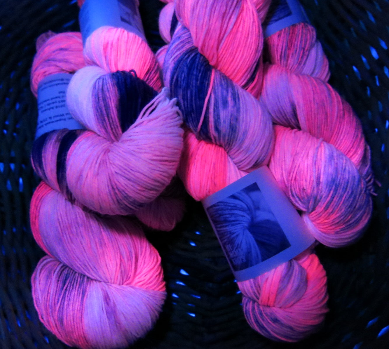 uv reactive pink yarn fluorescing under black light