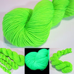 hand dyed bright neon green yarn fluorescing under uv black light
