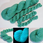 hand dyed jade green yarn fluorescing under uv black light