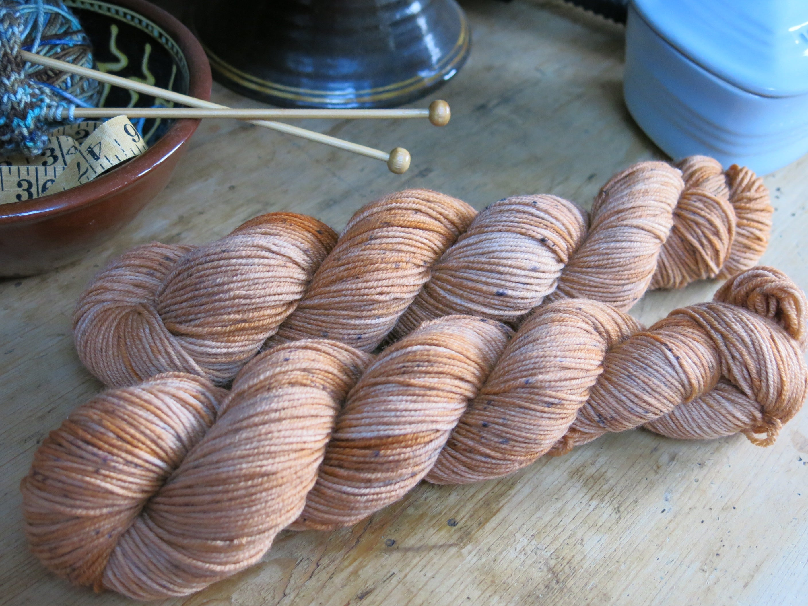 scottish whisky inspired speckled yarn skeins for knitting and crochet