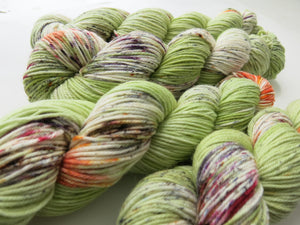 hand dyed green and orange speckled dk yarn skeins