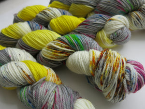 uv reactive yarn in yellow and grey with speckles