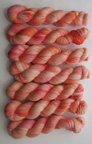 hand dyed superwash merino yarn in pastel orange