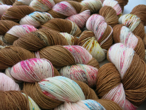indie dyed brown and pink speckled yarn skeins