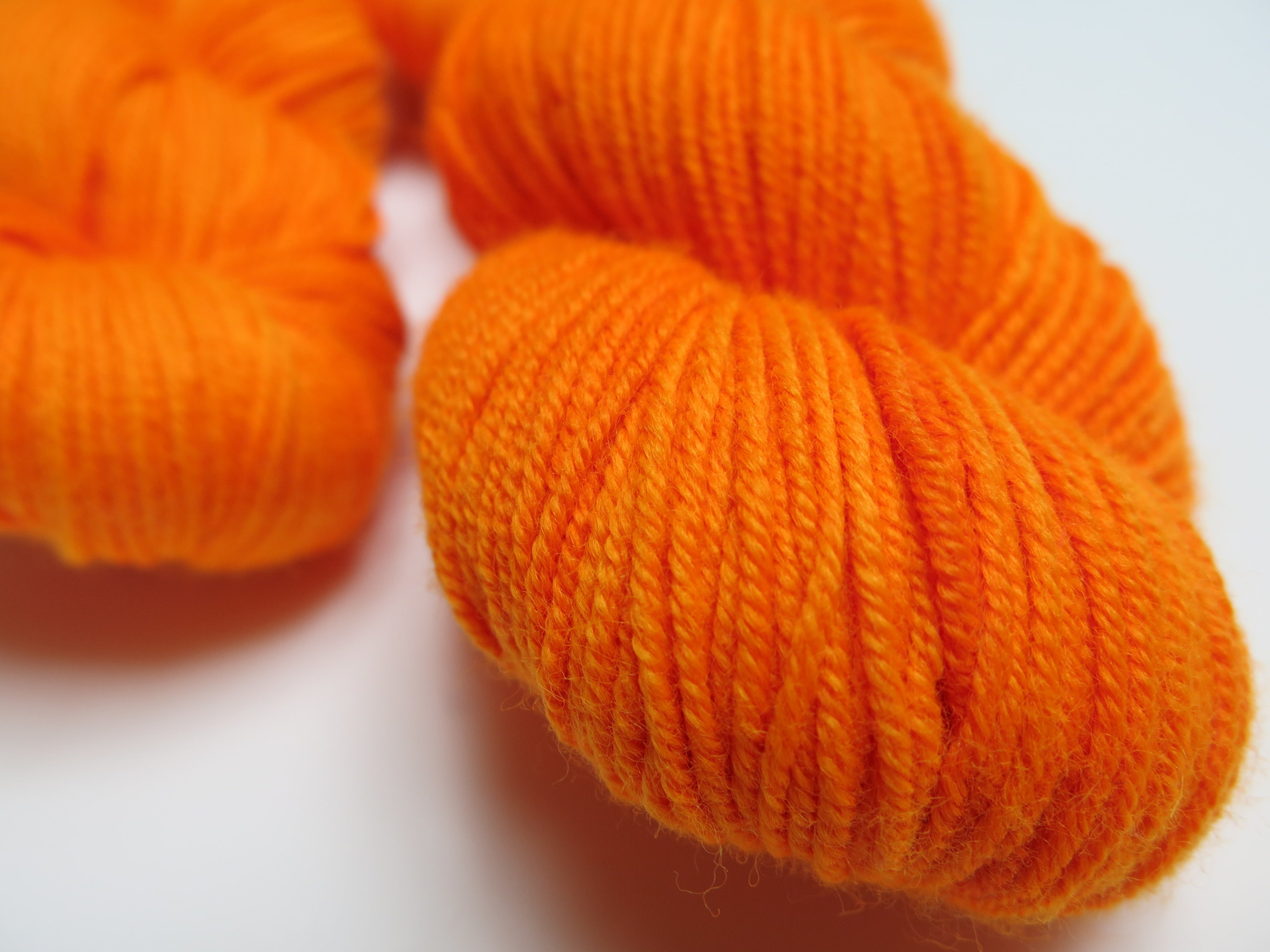 hand dyed uv reactive solid orange merino dk yarn
