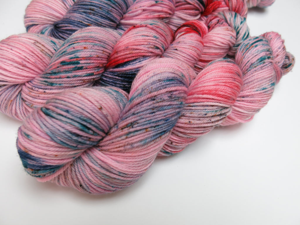 pink speckled hand dyed merino yarn skeins
