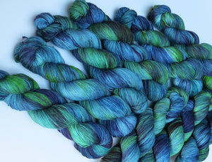 hand dyed blue and green merino and nylon sock yarn skeins