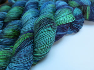 blue and green hand dyed uv reactive sock yarn