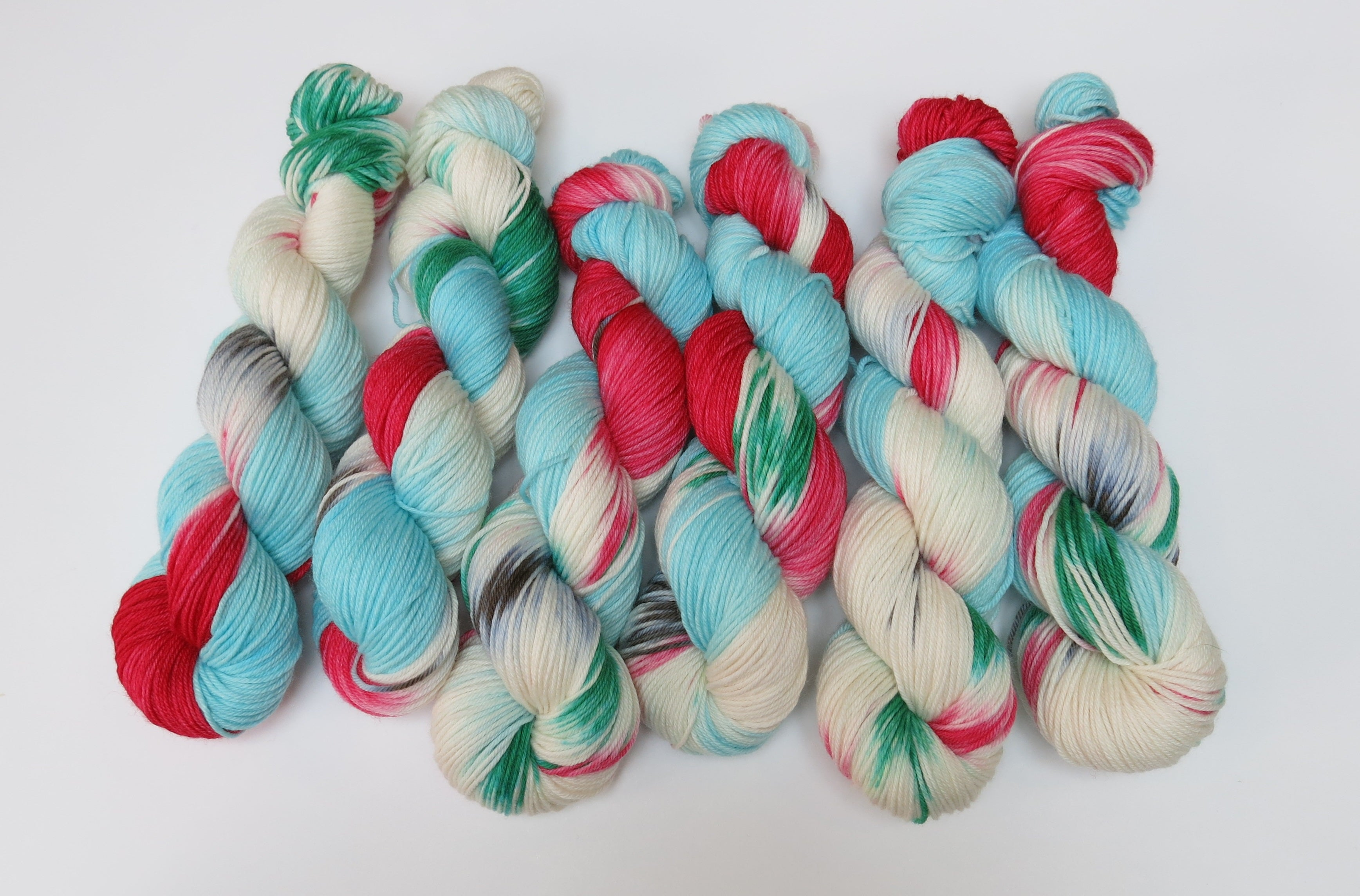 indie dyed christmas themed merino dk yarn skeins