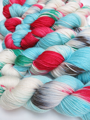 hand dyed christmas themed merino dk yarn skeins
