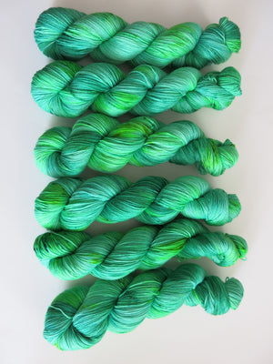 emerald city hand dyed superwash merino green yarn