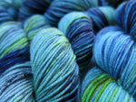 hand dyed green and blue uv reactive merino yarn skeins