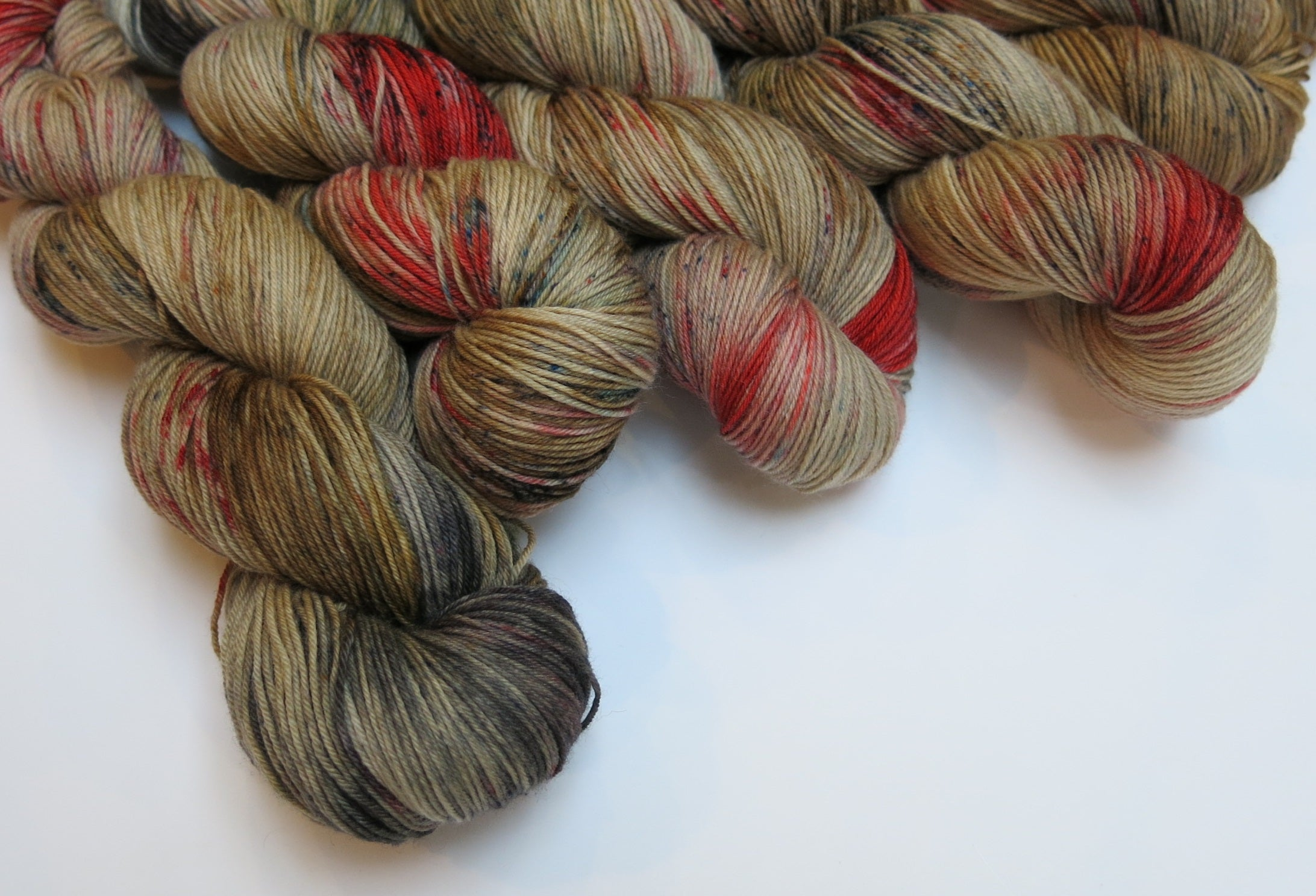 indie dyed brwon and red yarn skeins with speckles