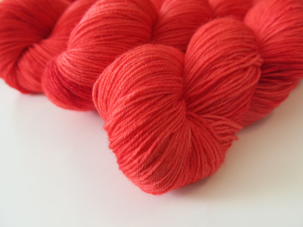hand dyed ruby red merino sock yarn skeins