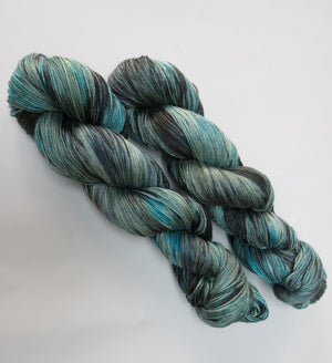 blue and black indie dyed mulberry silk sock weight yarn