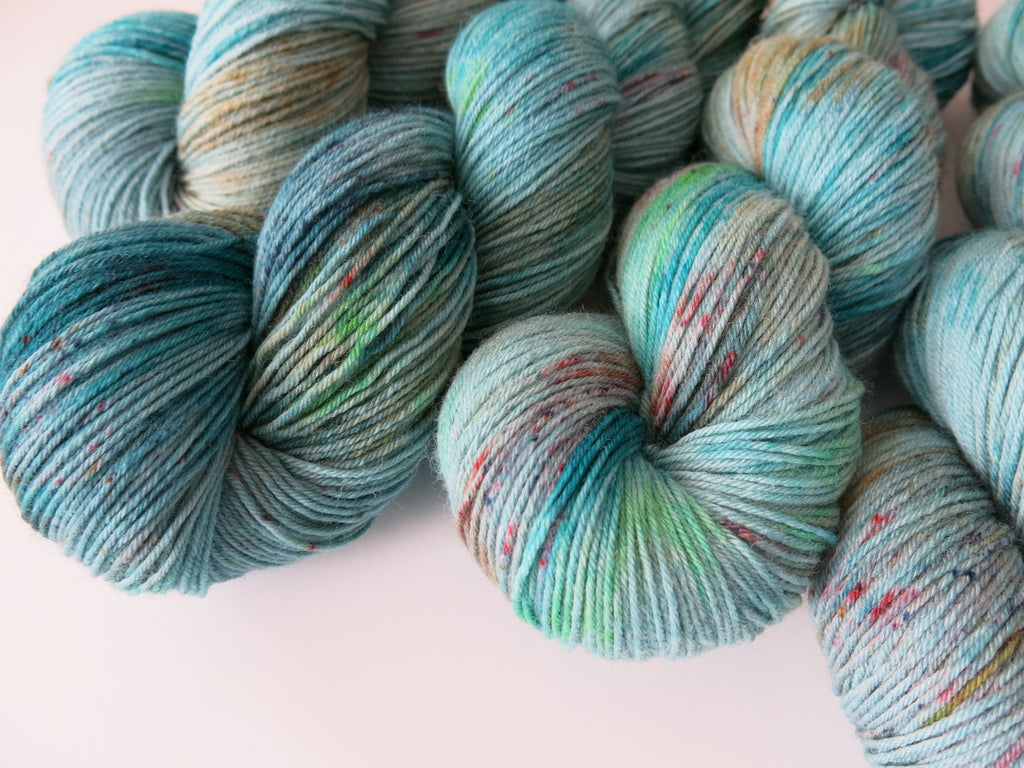 hand dyed speckled blue sock yarn skein