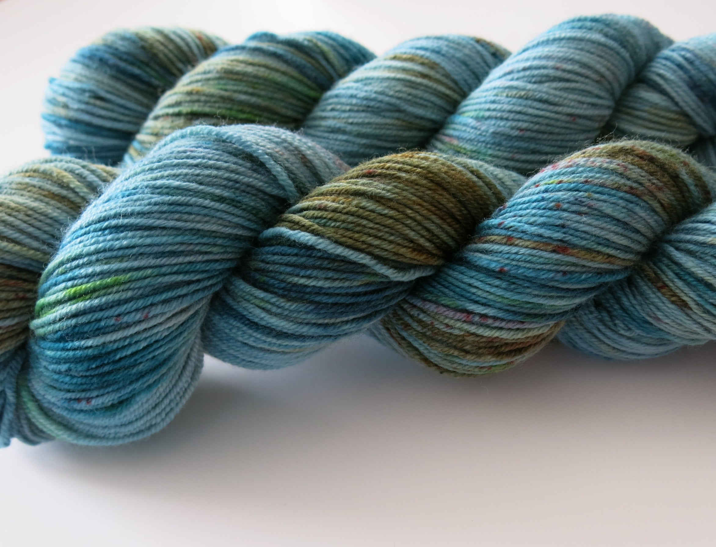 blue and green hand dyed merino wool for knitting and crochet