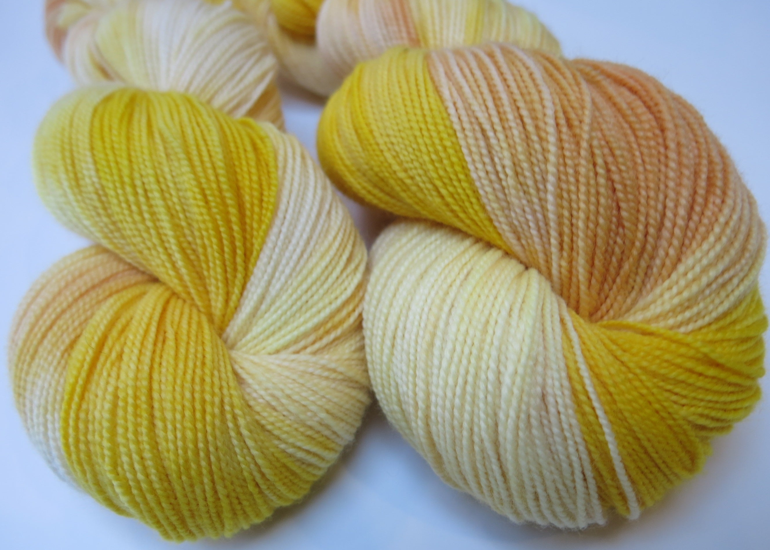 golden yellow kettle dyed merino sock yarn skeins