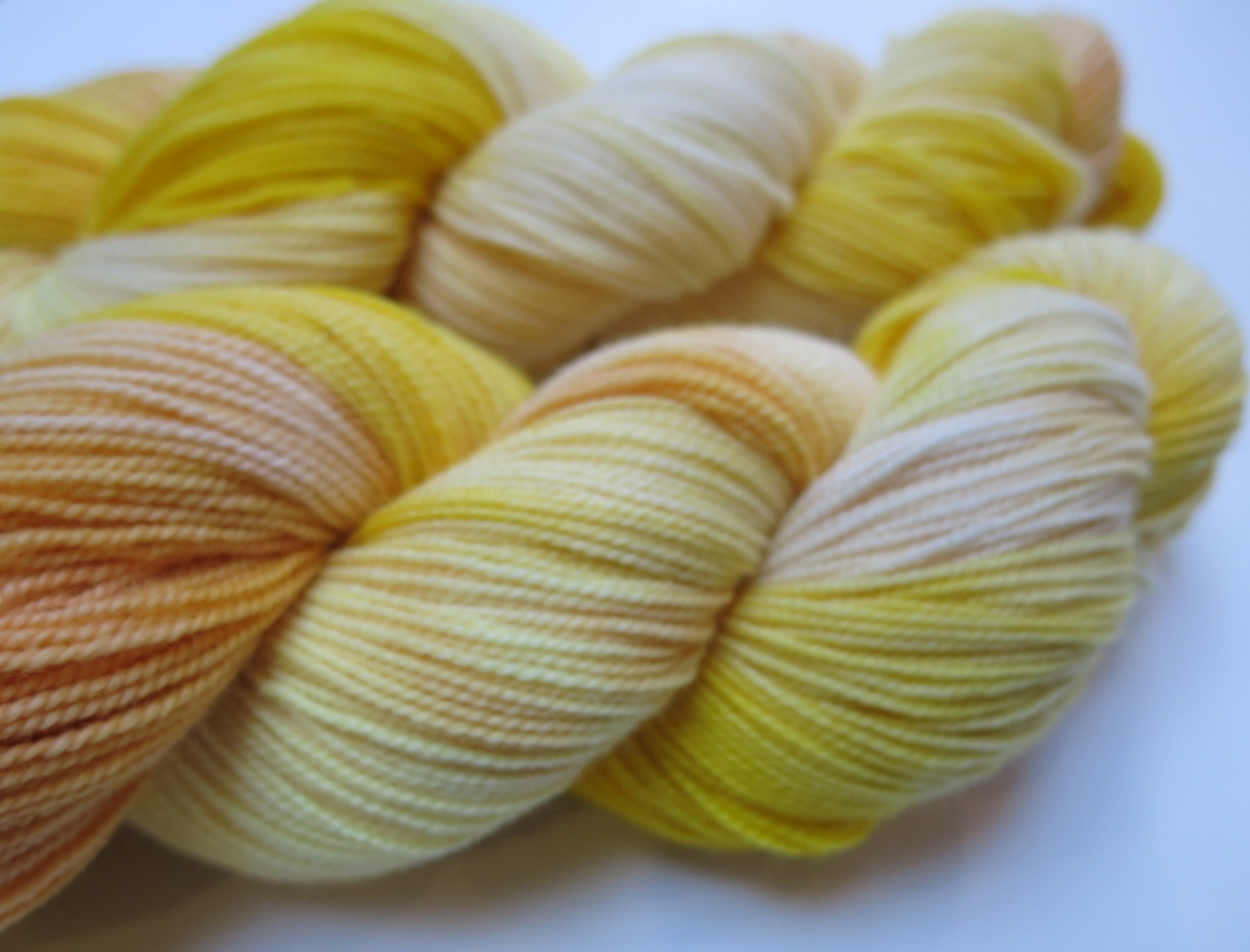yellow high twist merino sock yarn skeins