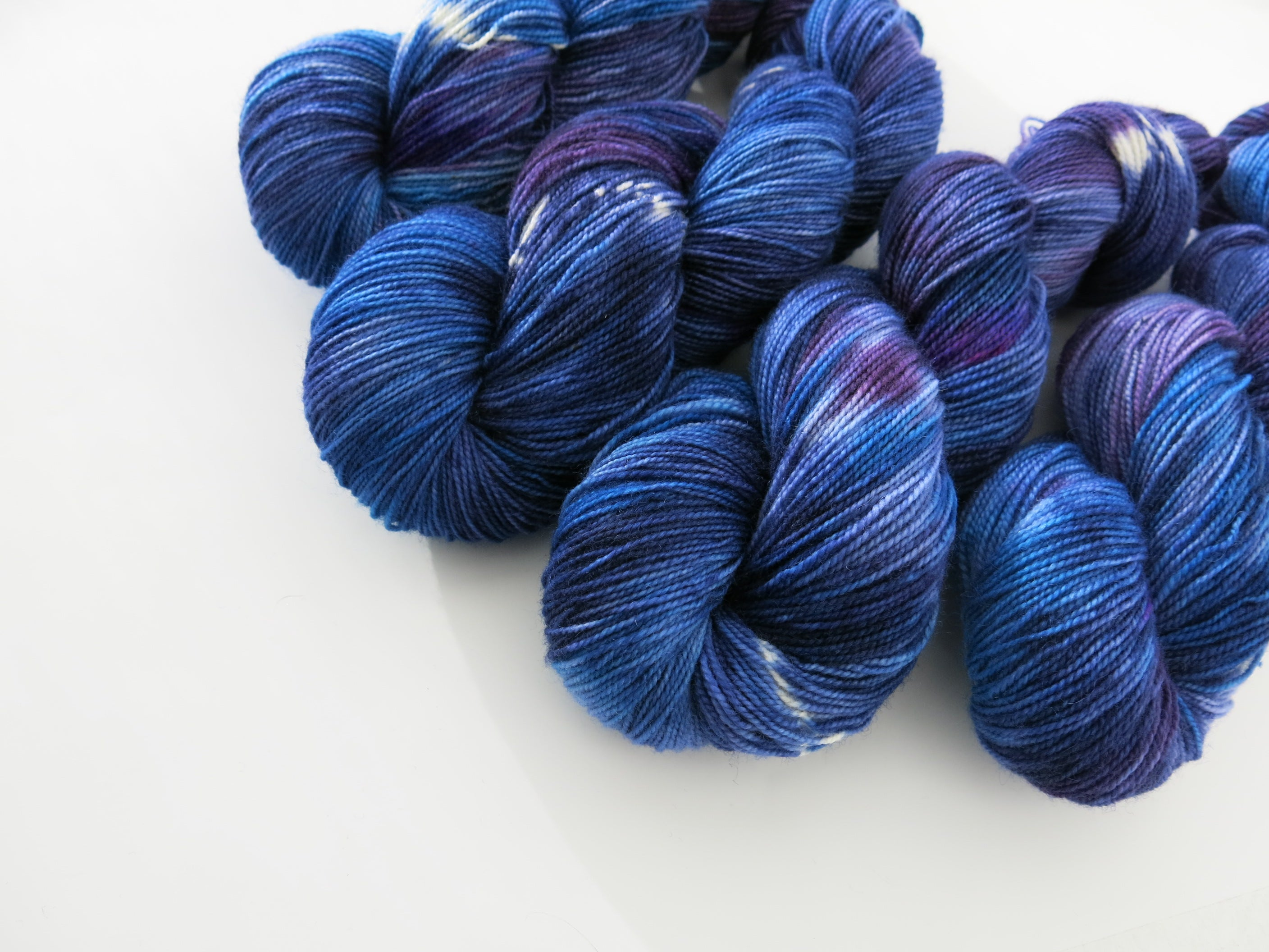 blue and purple hand dyed sock yarn skein