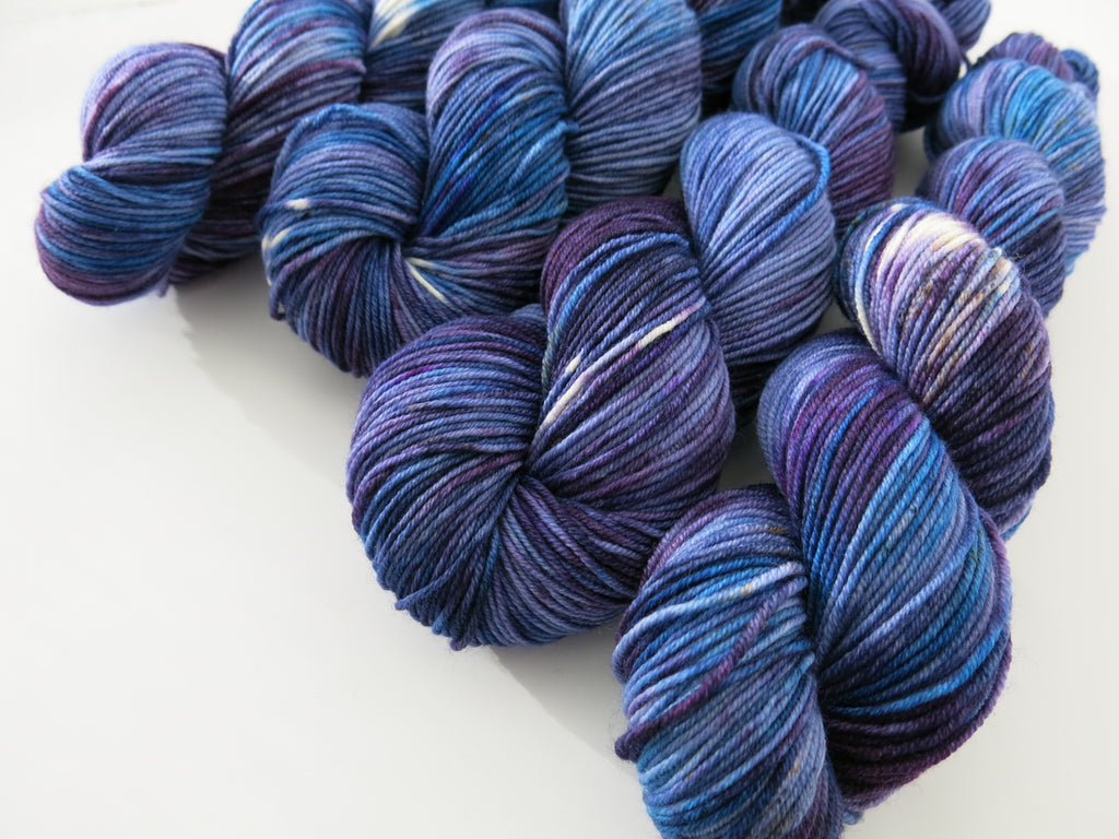 hand dyed blue and purple astronomy themed yarn skein