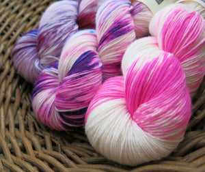hand dyed superwash sock yarn set in pink and purple
