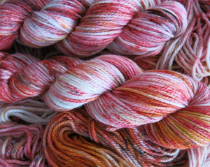 merino aran yarn skeins in orange and red