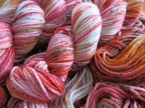 hand dyed and speckled merino aran yarn in orange