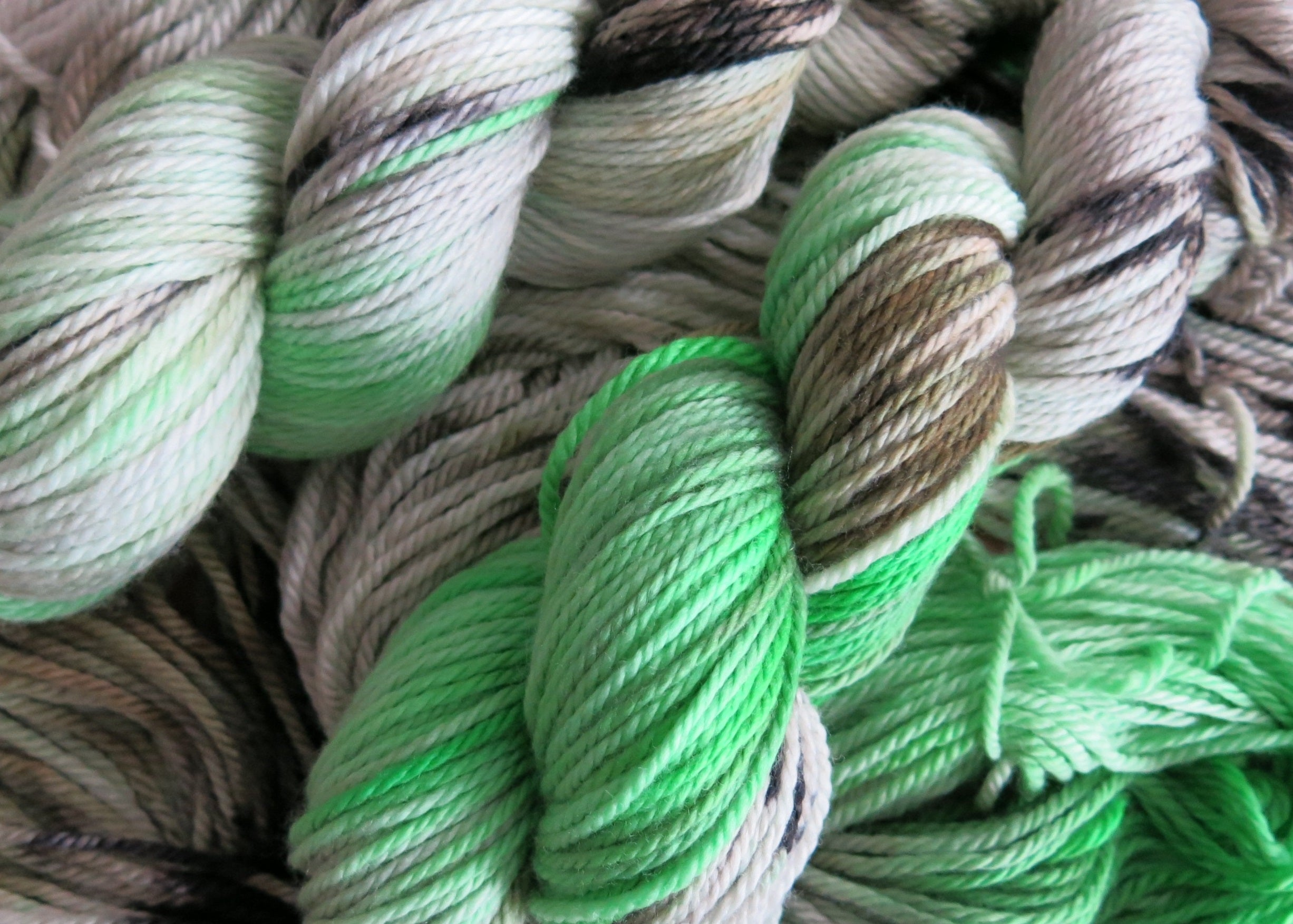 kettle dyed green and black aran wool skeins