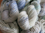 pastel speckled hand dyed superwash aran yarn skeins