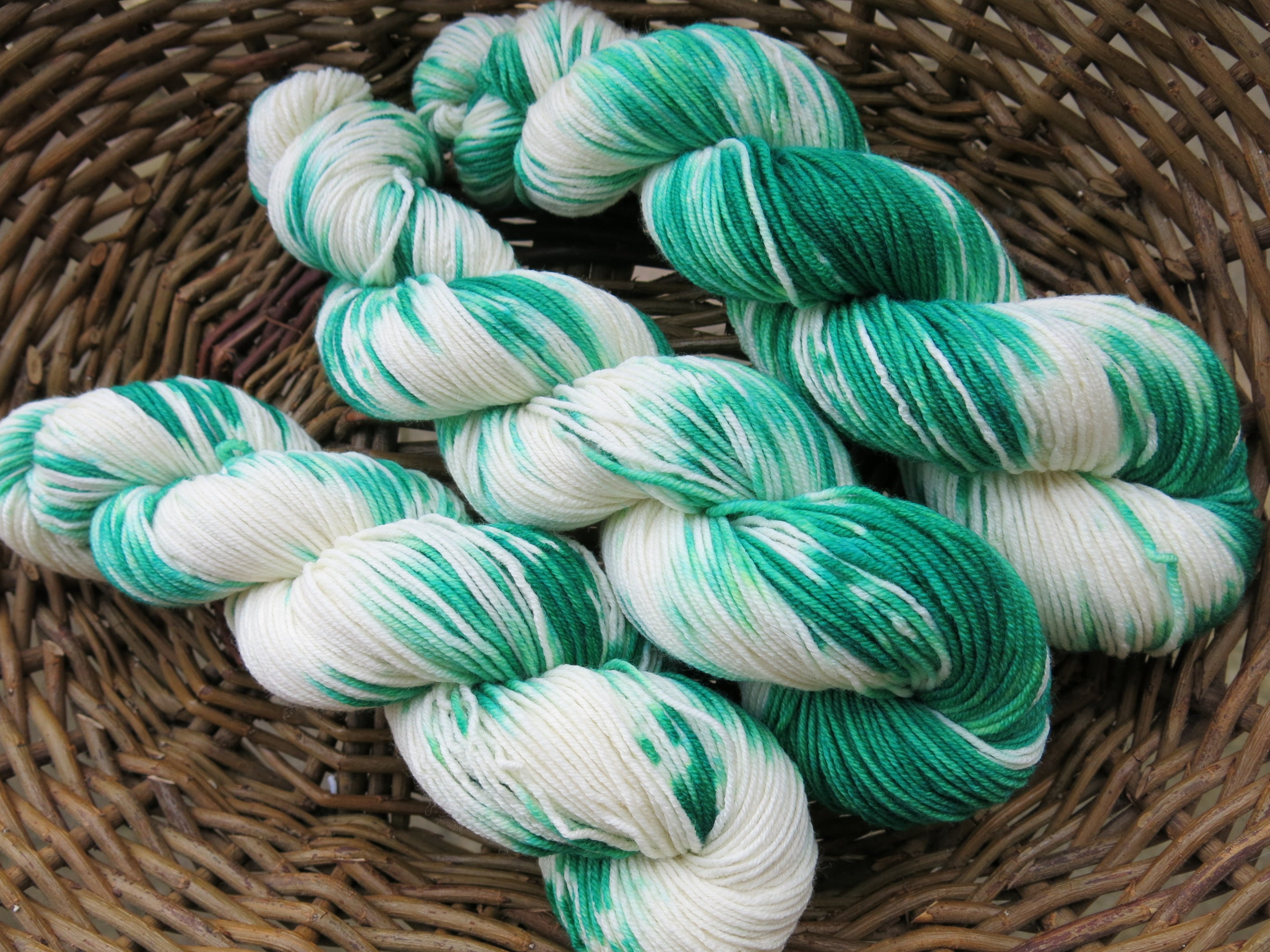 indie dyed green and white christmas yarn skeins