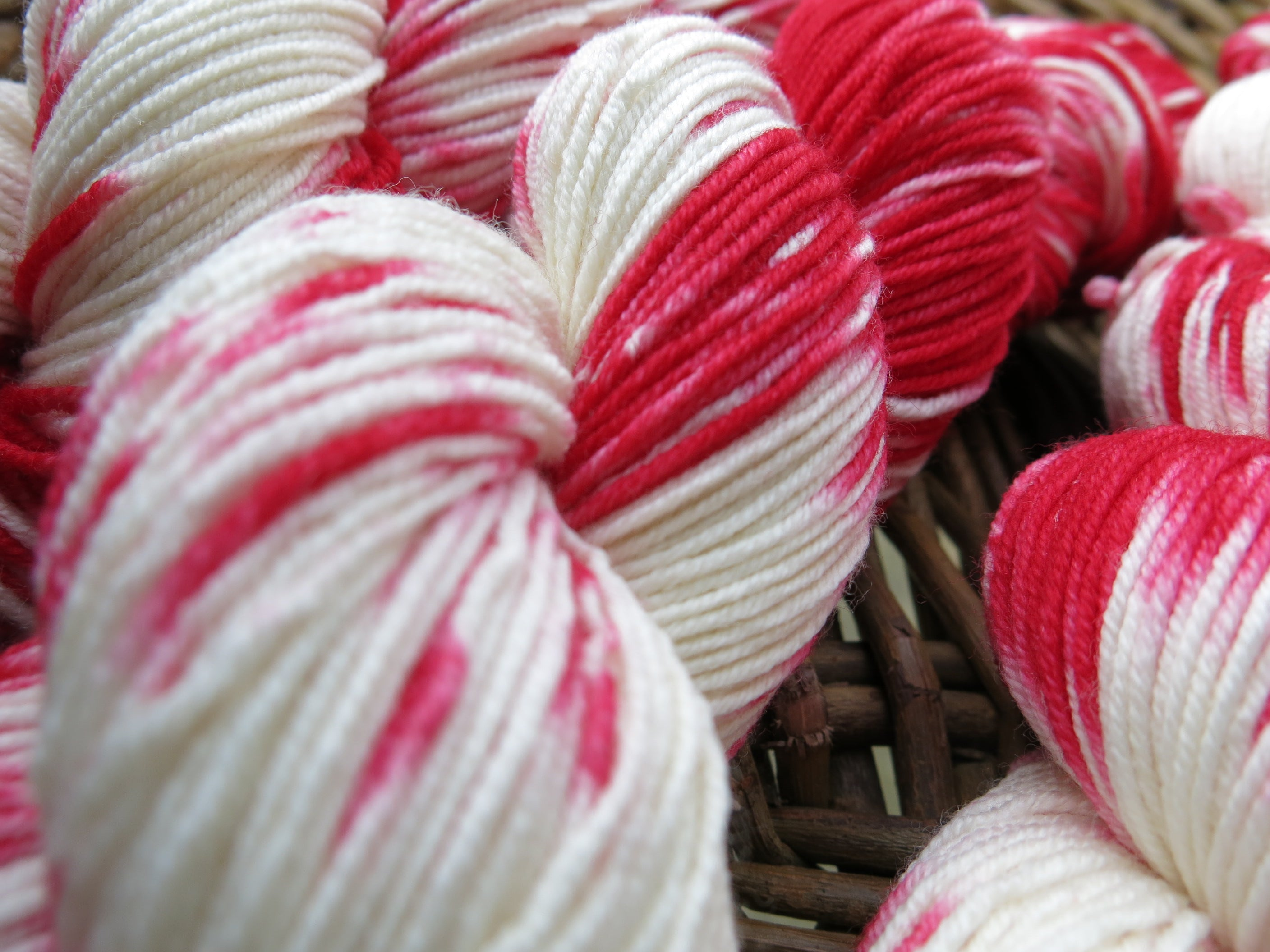 skeins of kettle dyed yarn in red and white