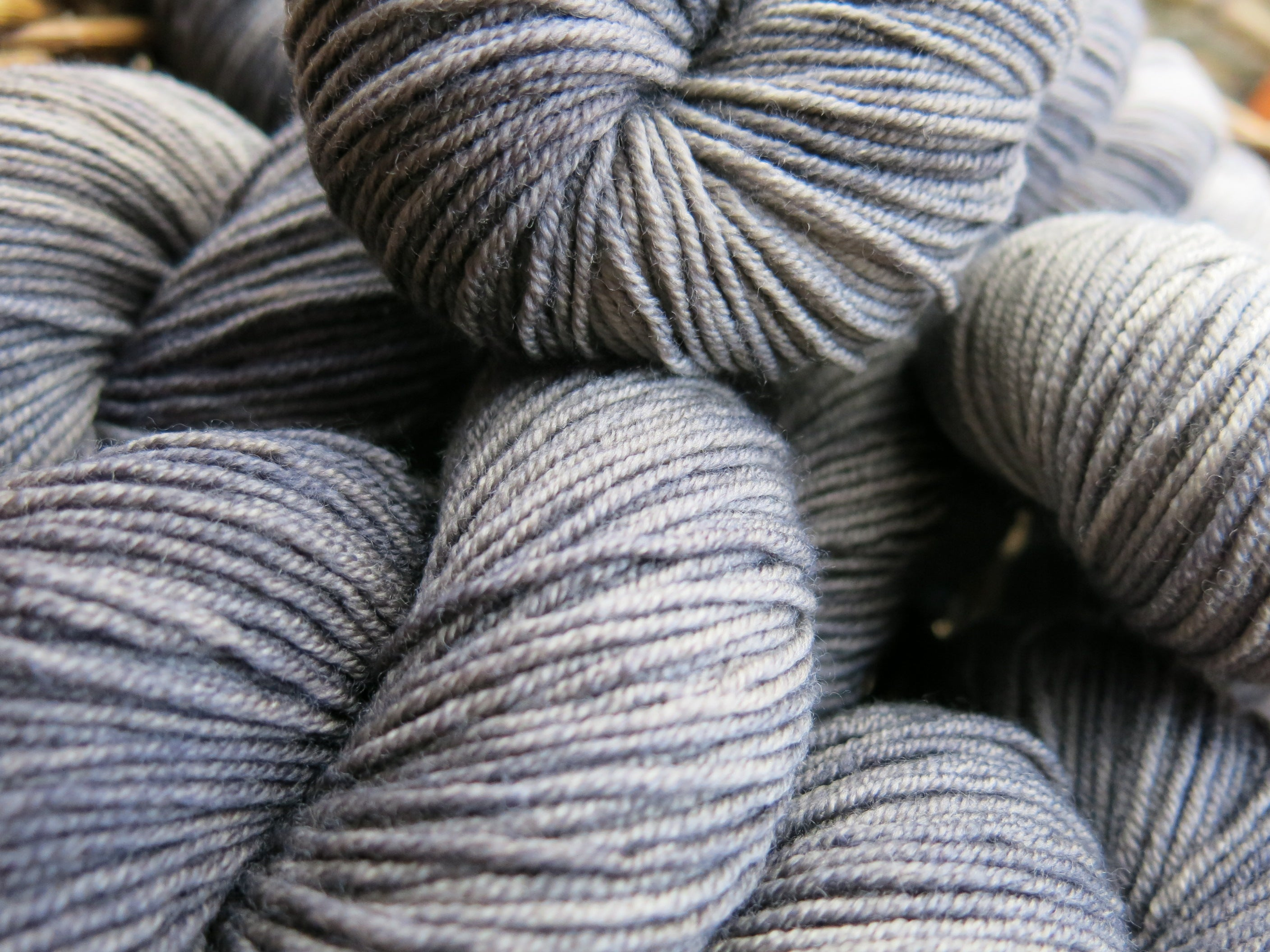 hand dyed tonal black and grey merino DK yarn skeins