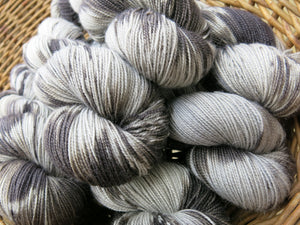 gray and black hand dyed yarn skeins