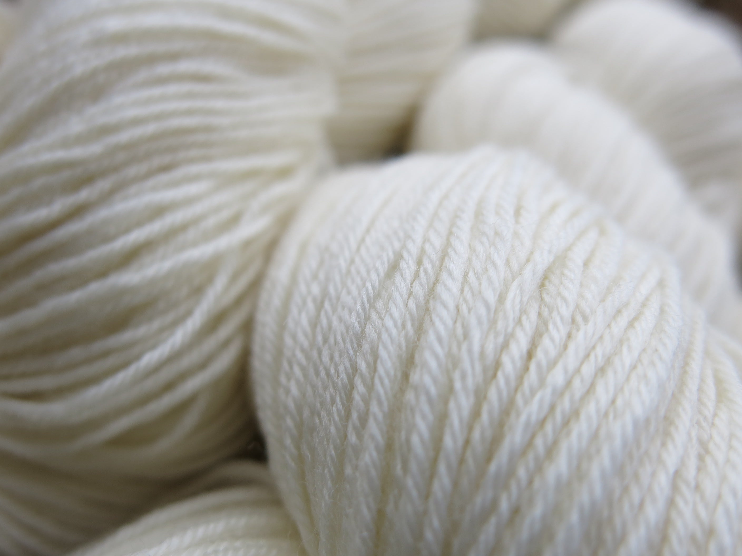 ecru undyed superwash merino and nylon sock yarn skein
