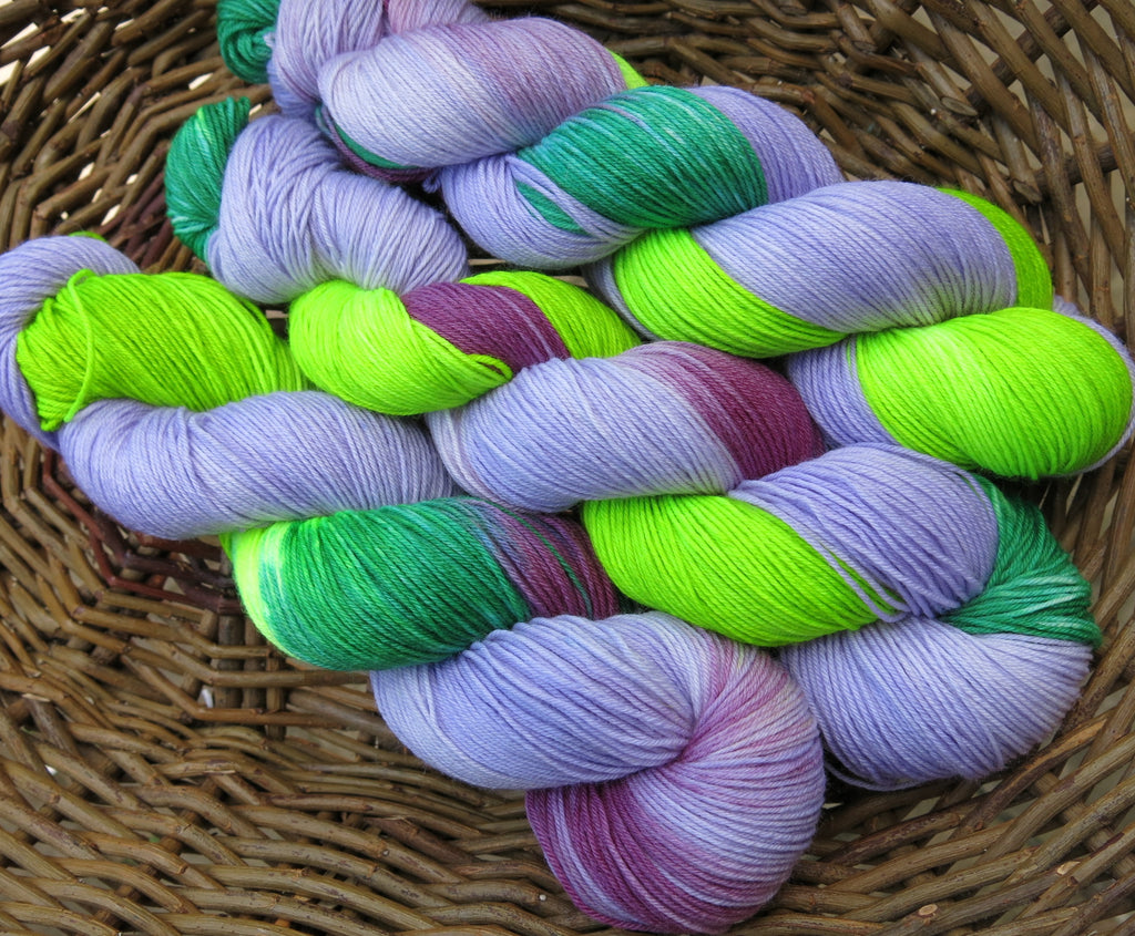 handdyed uv reacitve sock yarn in purple and green