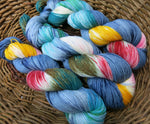hand dyed multi colour sock yarn with blue red yellow and green