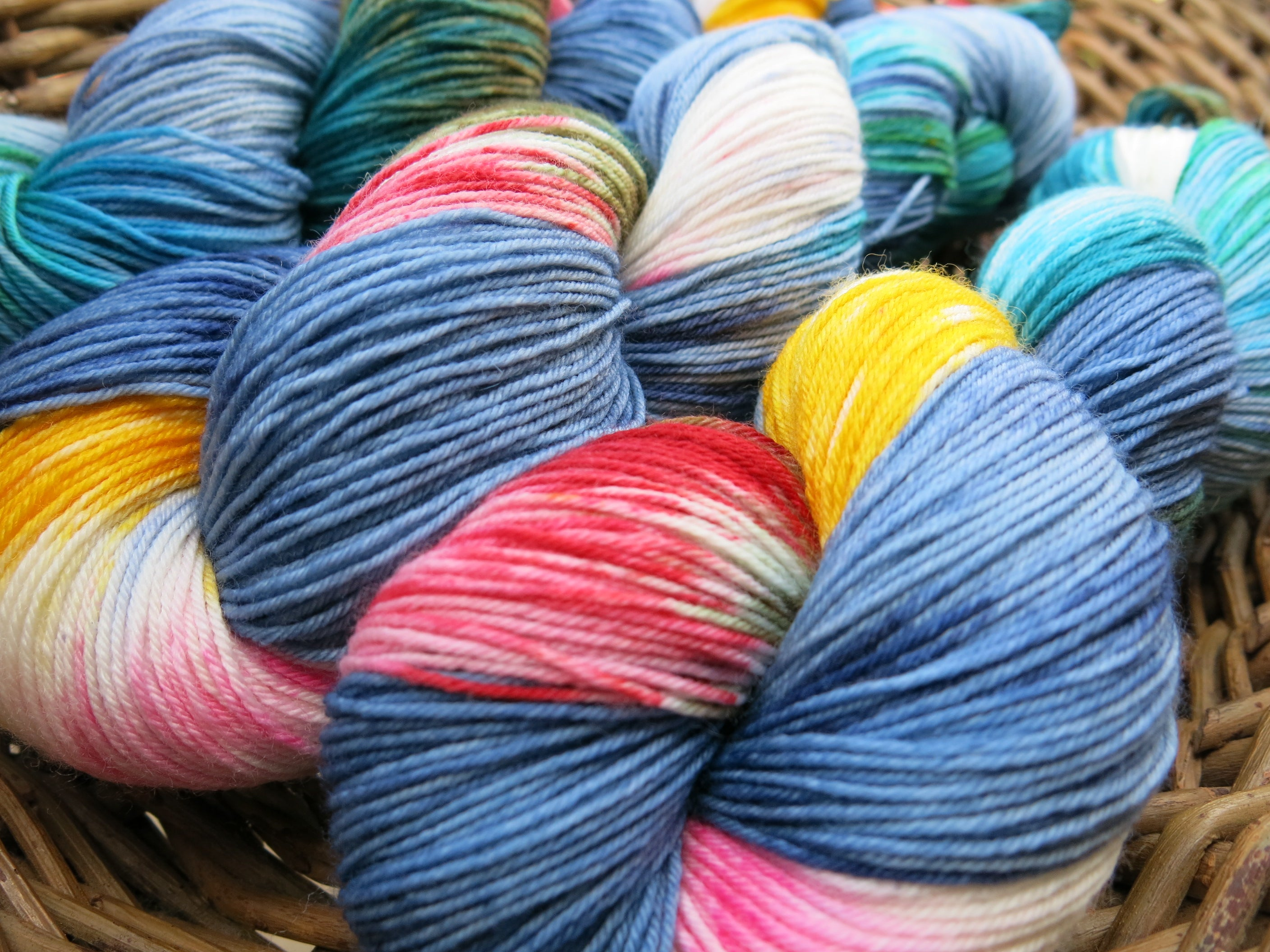 indie dyed Holtzmann superwash sock yarn skeins