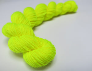 hand dyed yellow uv reactive mini skein