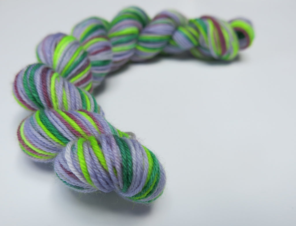 hand dyed uv reactive superwash sock yarn