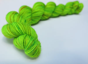 hand dyed uv reactive green sock yarn