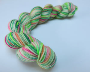 hand dyed uv reactive pink and green sock yarn