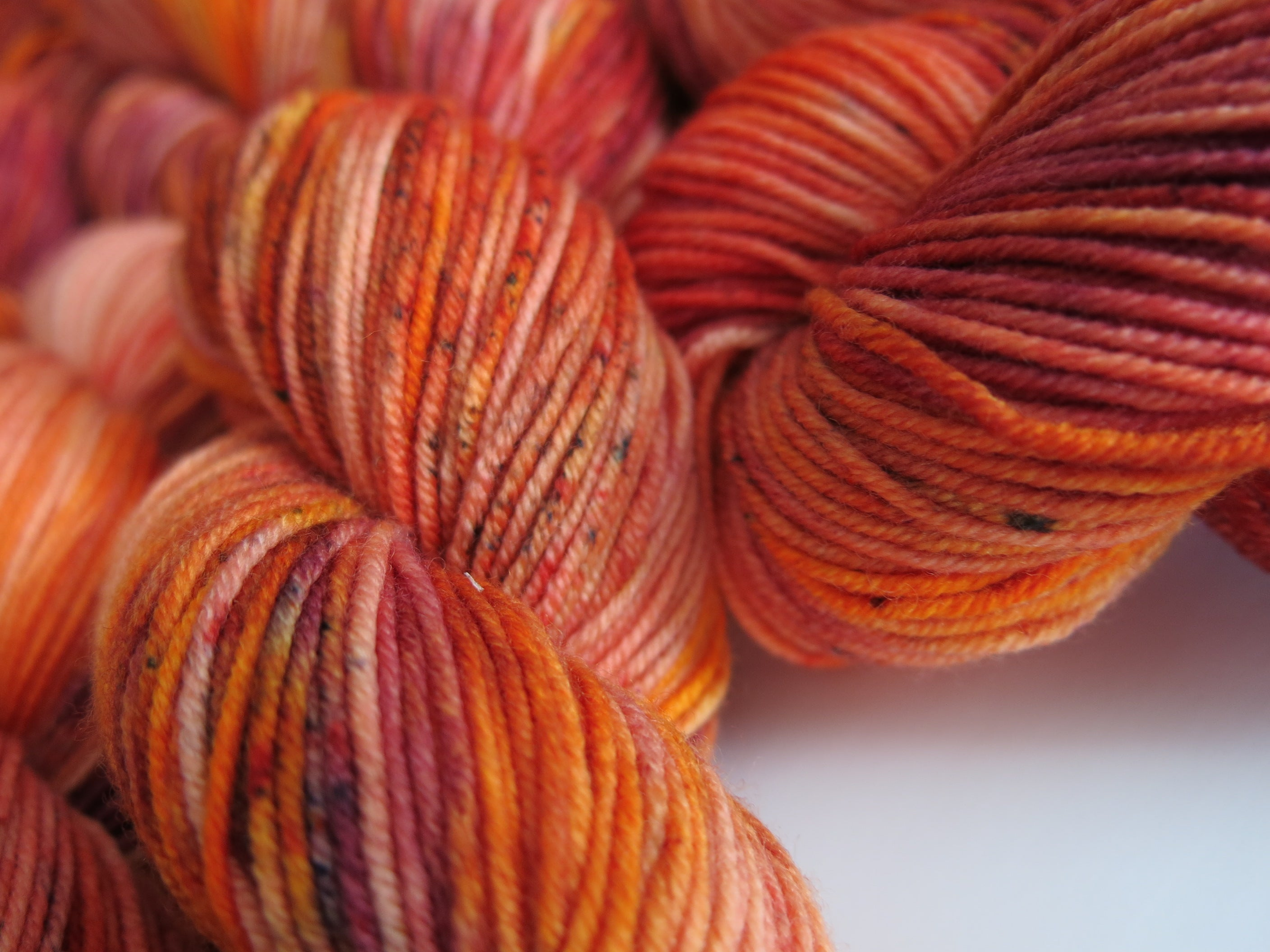 hand dyed uv reactive orange speckled dk 8 ply yarn